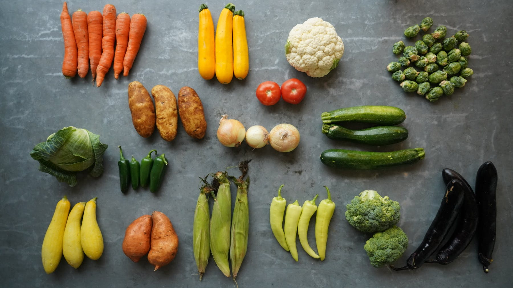 a bunch of different types of vegetables on a cutting board