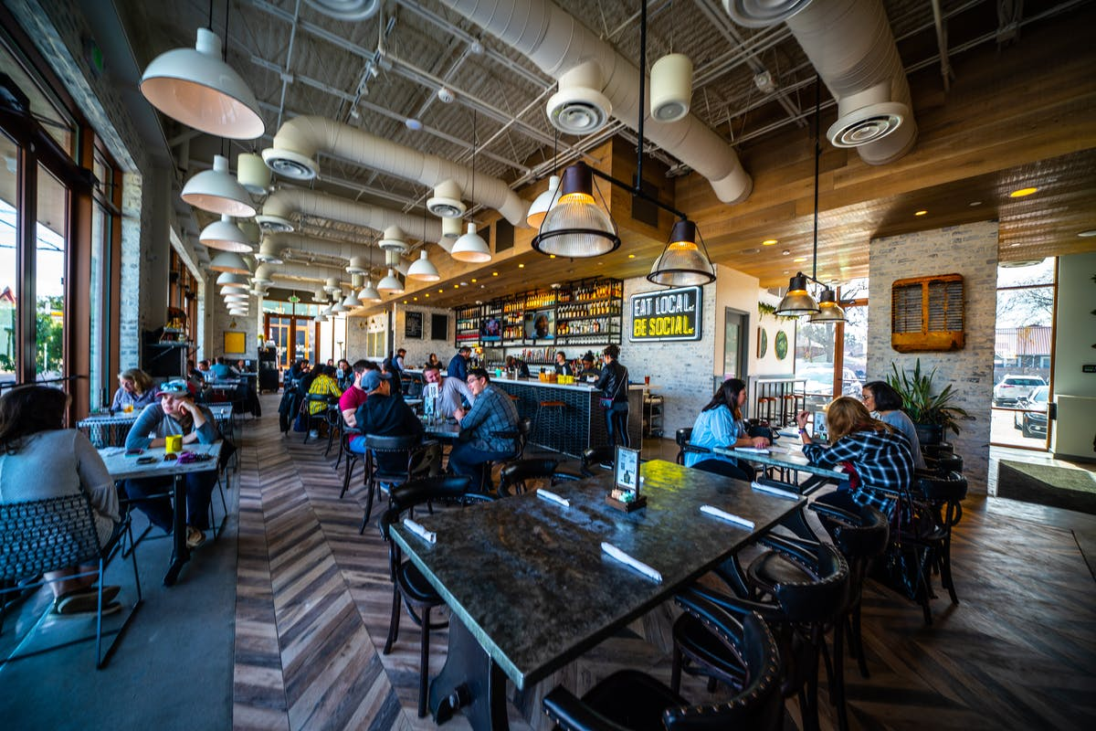 The Dish Society Heights Area location dining room is available for locally sourced breakfast, lunch, brunch, and dinner.