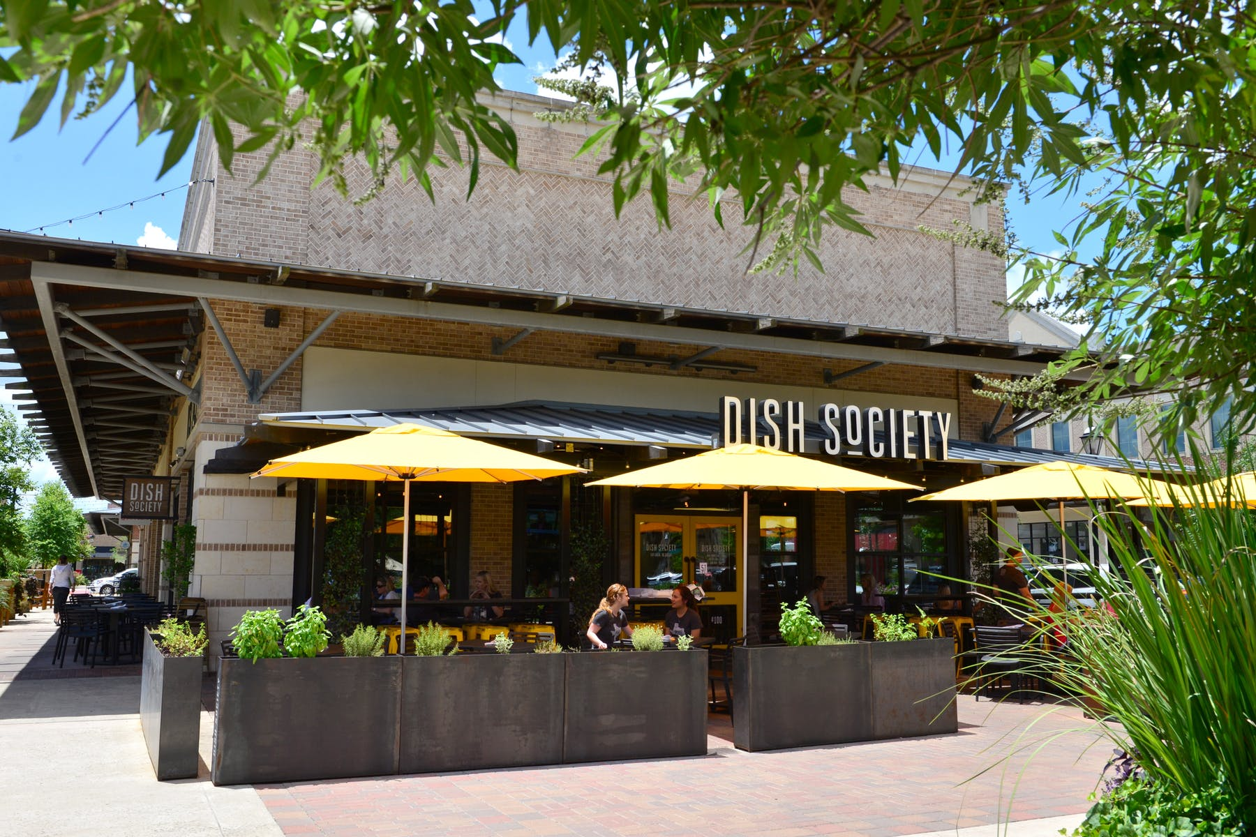 The Dish Society Katy Area location patio is available for locally sourced breakfast, lunch, brunch, and dinner.