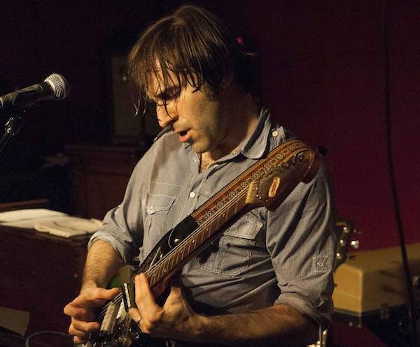 Chris Bergson playing the guitar