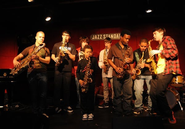 a group of people playing on the Jazz Standard stage