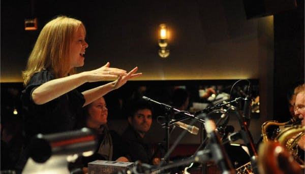 Maria Schneider leading the orchestra