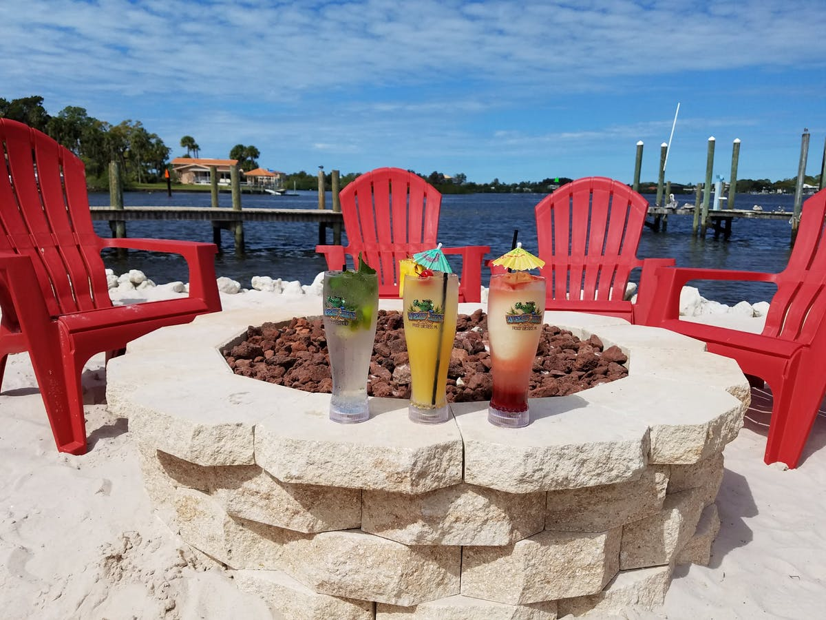 cocktails on a firepit by the beach