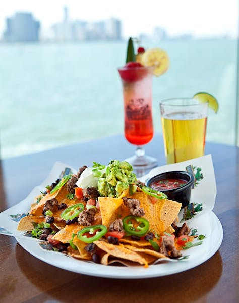 nachos and cocktails on a table
