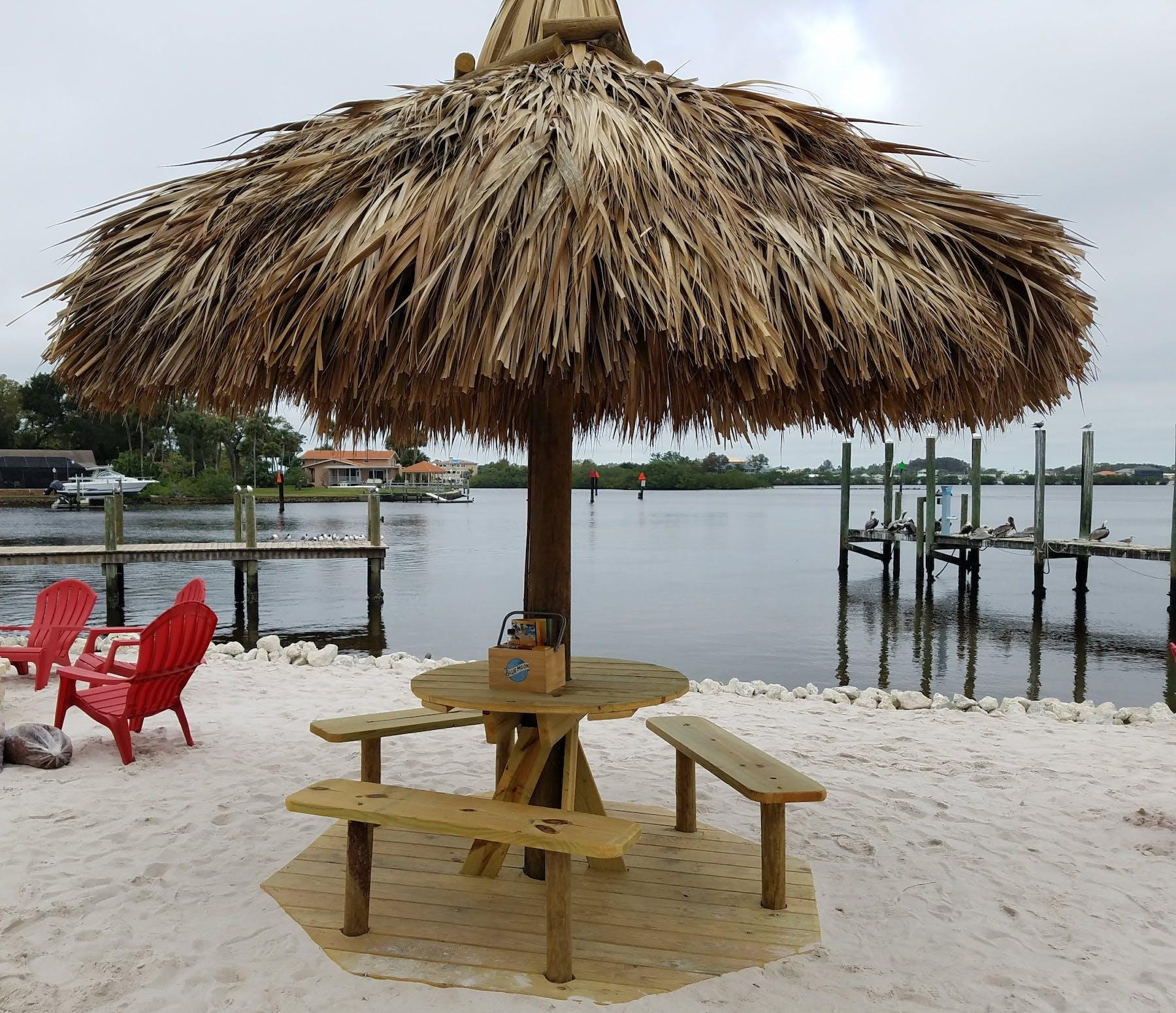 an umbrella sitting on top of a sandy beach