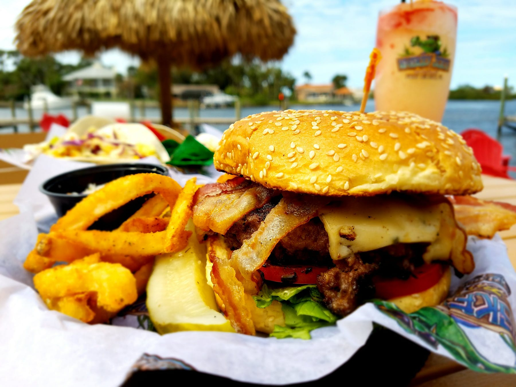 a close up of a sandwich and fries on a table