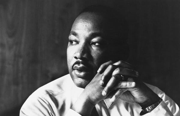 Martin Luther King, Jr. talking on a cell phone