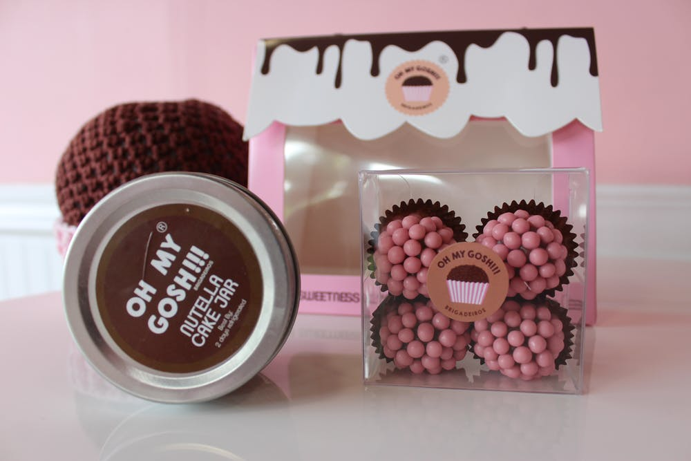 A box of pink chocolates and a Cake in a jar