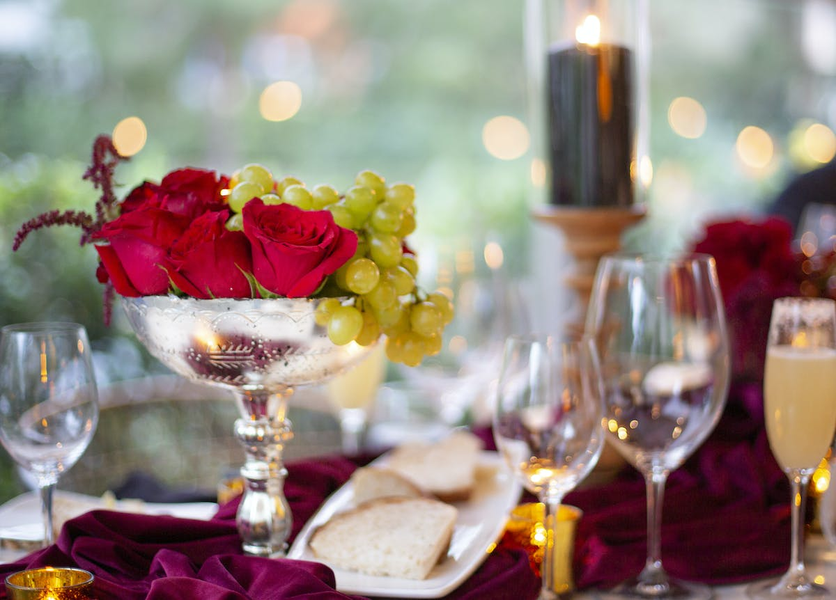 a table topped with glasses of wine