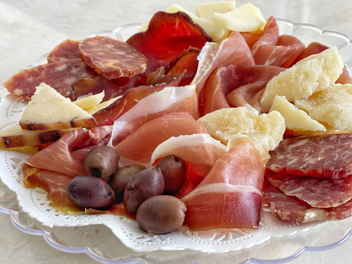 a plate of food with a slice of fresh fruit
