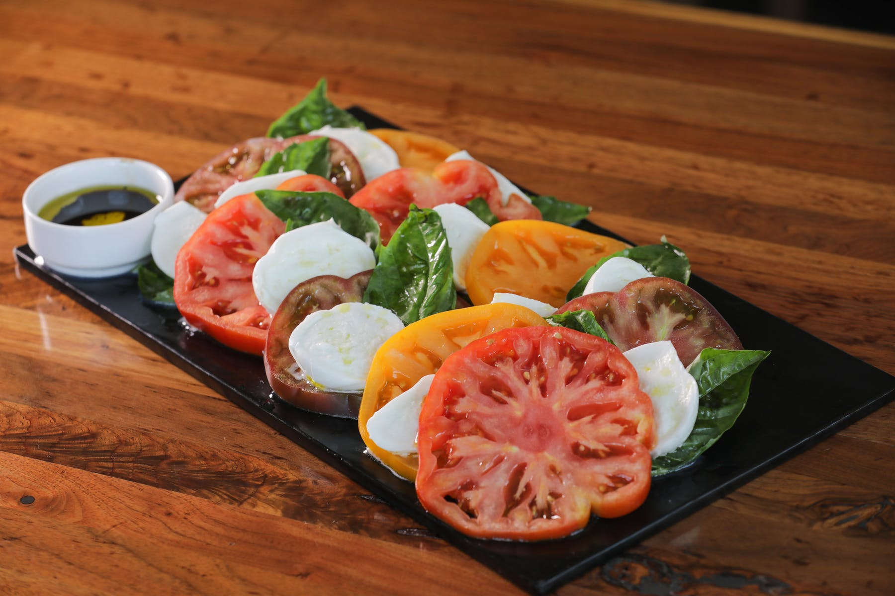 tomato slices with mozzarella and spinach