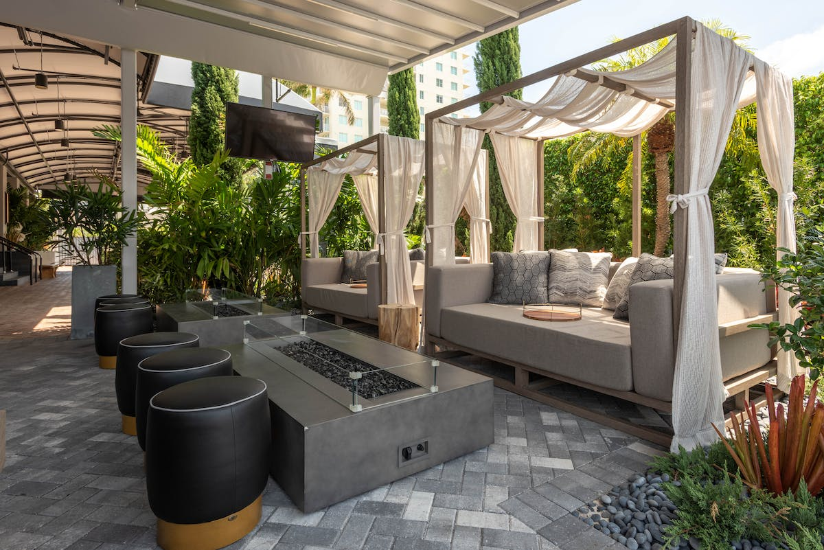 outdoor couches near a fireplace