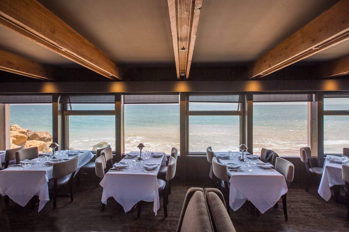 a dining room with ocean view