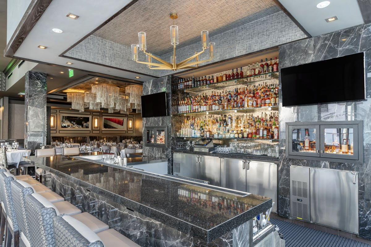bar with tv screen and drinks