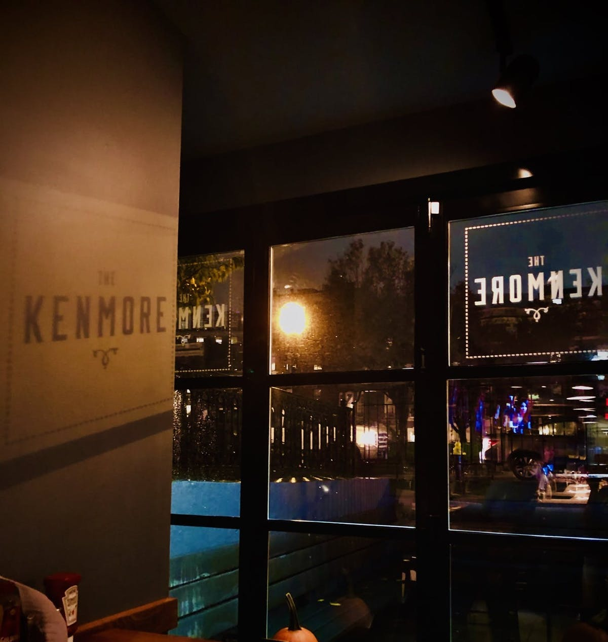 the kenmore logo on a window
