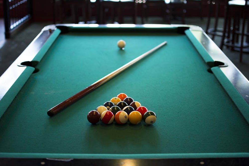 a table topped with a blue ball