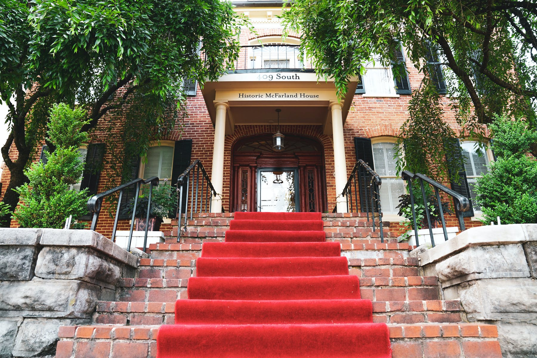 a brick staircase decorated with a red carpet
