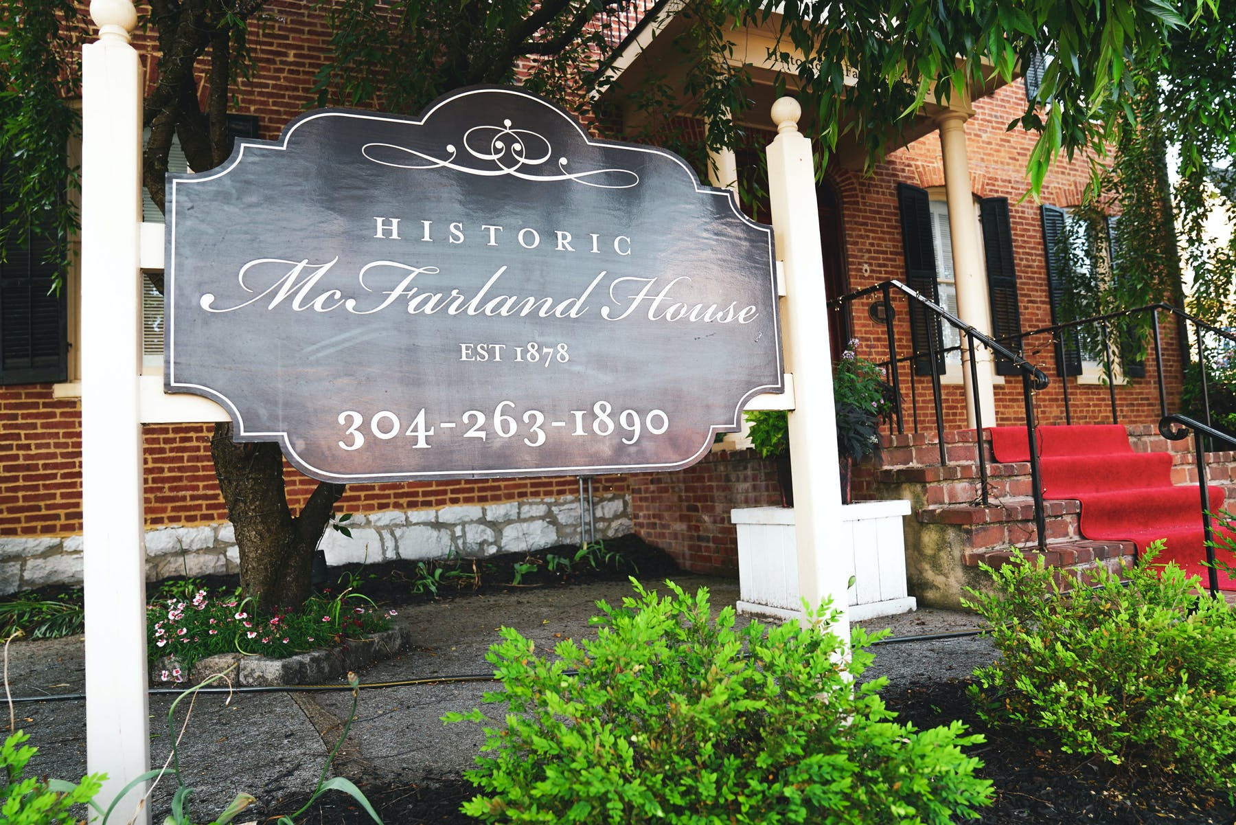 a close up of the Historic McFarland House sign