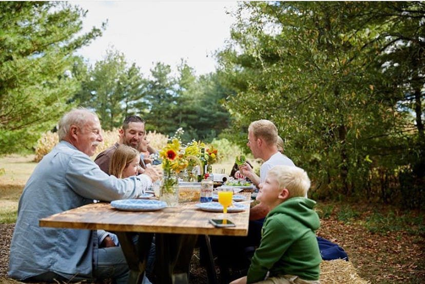 Family eating at a picnic table